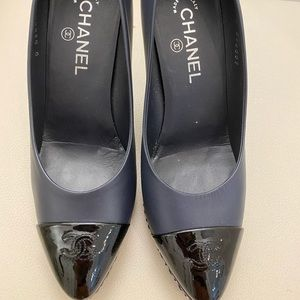 Navy Chanel pumps with patent black cap toe
